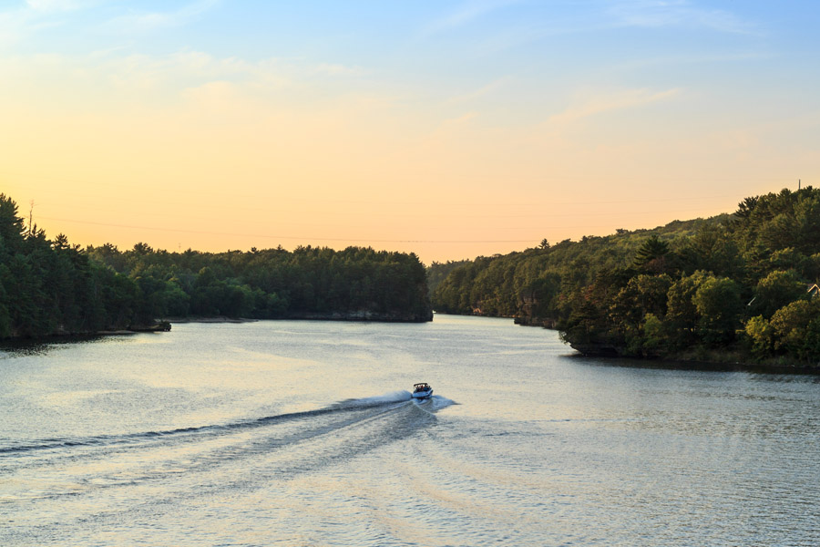 About Our Agency - Speed Boat Driving Along Rivers in WI at Sunset