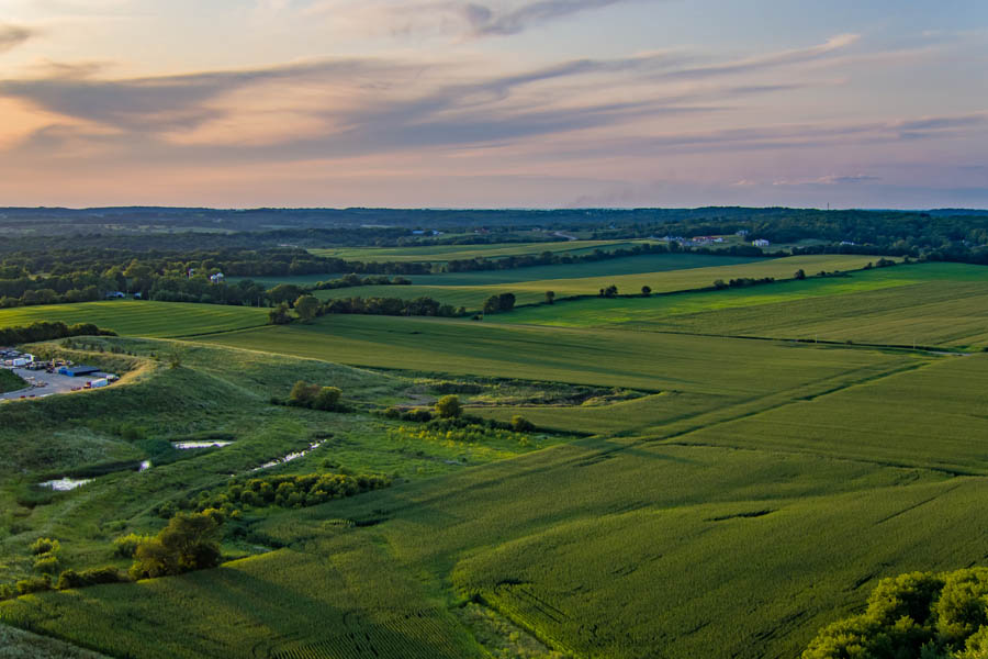 Capital-Richter Insurance Services - View of a WI Farmland at Sunset with Bright Green Grass