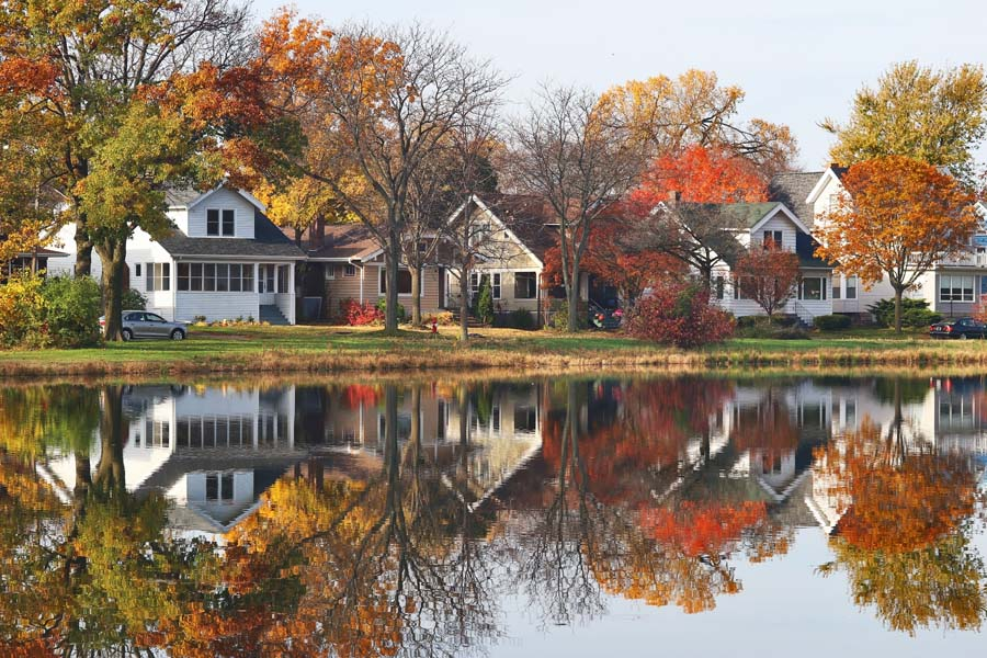 Contact Us - WI Fall Overlooking the Water with Homes in the Background