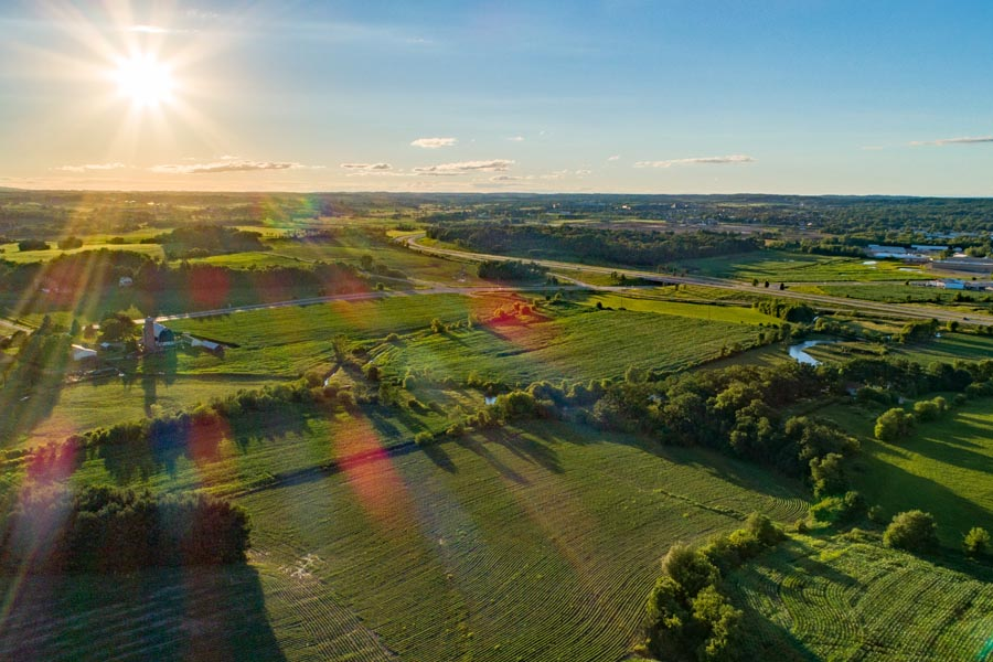Germantown, WI Insurance - Rising Sun Over WI Farmland in Summertime