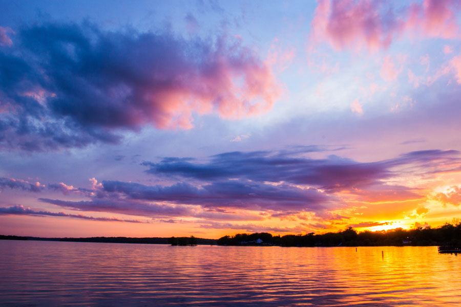 Pewaukee, WI Insurance - Pewaukee Lake View of a Sunset with Bright Purples and Oranges